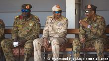 KHARTOUM, SUDAN - SEPTEMBER 22: Chairman of the Sovereignty Council of Sudan, Gen. Abdel Fattah Abdelrahman al-Burhan and Deputy Chairman of the Sovereignty Council, Mohamed Hamdan Dagalo attend a military graduation ceremony of special forces, in Khartoum, Sudan on September 22, 2021. Mahmoud Hjaj / Anadolu Agency