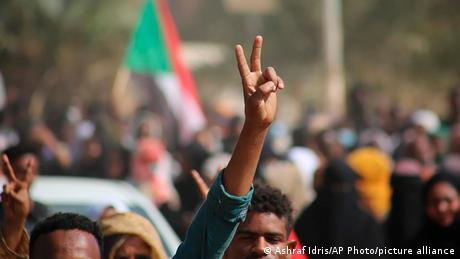 Pro-democracy protesters flash the victory sign as they take to the streets