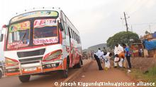 (211025) -- MPIGI (UGANDA), Oct. 25, 2021 (Xinhua) -- Investigators work at the scene following an explosion on a bus in Lungala, Mpigi District, central Uganda, on Oct. 25, 2021. Two people were killed on Monday in the central Ugandan district of Mpigi after an explosion on the bus traveling from the capital Kampala to the western district of Bushenyi, a police spokesperson said. (Photo by Joseph Kiggundu/Xinhua)