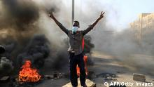 Sudanese protesters burn tyres to block a road in 60th Street in the capital Khartoum