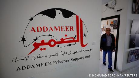 man walks through doorway of Addameer offices
