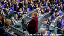 German Chancellor Angela Merkel looks around during the first plenary session of the German parliament Bundestag after the elections, Berlin, Tuesday, Oct. 26, 2021. At right German President Frank-Walter Steinmeier. (Photo/Markus Schreiber)