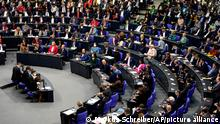 Lawmakers attend the first plenary session of the German parliament Bundestag after the elections, Berlin, Tuesday, Oct. 26, 2021. At right German President Frank-Walter Steinmeier. (Photo/Markus Schreiber)