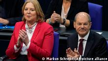 Social democratic candidate for chancellor Olaf Scholz, right, sits next to designated parliament president Baerbel Bas during the first plenary session of the German parliament Bundestag after the elections, Berlin, Tuesday, Oct. 26, 2021. (Photo/Markus Schreiber)