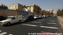 Cars wait in line to fill up at a gas station because pumps machines are out of service, in Tehran, Iran, Tuesday, Oct. 26, 2021. Gas stations across Iran on Tuesday suffered a widespread outage of a system that allows consumers to buy fuel with a government-issued card, stopping sales. One semiofficial news agency referred to the incident as a cyberattack. (AP Photo/Vahid Salemi)