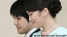 Photo taken Sept. 3, 2017, shows Japanese Princess Mako and her boyfriend Kei Komuro attending a press conference in Tokyo's Motoakasaka district after the Imperial Household Agency announced they will marry, possibly in fall 2018. After a nearly three-year postponement of their marriage following a financial dispute involving his mother, the princess and Komuro are set to marry on Oct. 26, 2021. (Kyodo)