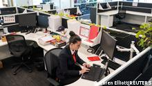 Maddison Thomas, a business manager at MSS Security provider, works in the company's mostly empty office following an extended coronavirus disease (COVID-19) lockdown in Sydney, Australia, October 26, 2021. REUTERS/Loren Elliott