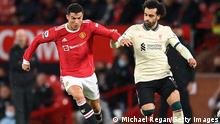 MANCHESTER, ENGLAND - OCTOBER 24: Cristiano Ronaldo of Manchester United holds off Mohamed Salah of Liverpool during the Premier League match between Manchester United and Liverpool at Old Trafford on October 24, 2021 in Manchester, England. (Photo by Michael Regan/Getty Images)