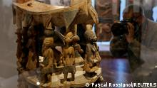 A Royal seat, Benin, Cana (18th-19th century) is displayed during the exhibition Restitution of 26 works from the royal treasury in Abomey at the Quai Branly museum before a ceremony to mark the return of 26 artworks of the Kingdom of Dahomey to Benin, in Paris, France, October 26, 2021. Picture taken October 26, 2021. REUTERS/Pascal Rossignol