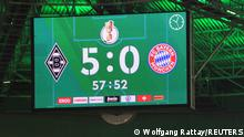 Soccer Football - DFB Cup - Second Round - Borussia Moenchengladbach v Bayern Munich - Borussia-Park, Moenchengladbach, Germany - October 27, 2021 General view of the big screen displaying the score REUTERS/Wolfgang Rattay DFB RULES PROHIBIT USE IN MMS SERVICES VIA HANDHELD DEVICES UNTIL TWO HOURS AFTER A MATCH AND ANY USAGE ON INTERNET OR ONLINE MEDIA SIMULATING VIDEO FOOTAGE DURING THE MATCH..