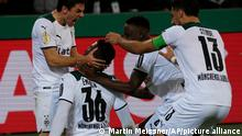 Moenchengladbach's Breel Embolo, second left, celebrates after scoring his side's fourth goal during the German Soccer Cup match between Borussia Moenchengladbach and Bayern Munich at the Borussia Park in Moenchengladbach, Germany, Wednesday, Oct. 27, 2021. (AP Photo/Martin Meissner)
