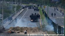 Police advance on people protesting the rise in gas prices and the policies of Ecuador's President Guillermo Lasso, on the second day of a general, nation-wide strike, in Quito, Ecuador, Wednesday, Oct. 27, 2021. (AP Photo/Dolores Ochoa)