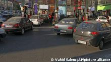 People fill their cars at a gas station in Tehran, Iran Wednesday, Oct. 27, 2021. Iran's President Ebrahim Raisi said Wednesday that a cyberattack which paralyzed every gas station in the Islamic Republic was designed to get people angry by creating disorder and disruption. Long lines snaked around the pumps a day after the incident began as some stations began selling fuel again although at higher, unsubsidized prices. (AP Photo/Vahid Salemi)