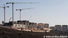 (FILES) This file photo taken on October 5, 2021, shows a view of construction work in the Jewish settlement of Givat Zeev, near the Israeli-occupied West Bank city of Ramallah. - Israel plans to build more residences for Jewish settlers in the occupied West Bank, a government ministry said, adding to those announced in August by the new ruling coalition. (Photo by AHMAD GHARABLI / AFP)