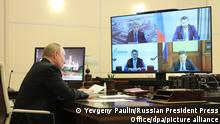 MOSCOW REGION, RUSSIA - OCTOBER 27, 2021: Russia's President Vladimir Putin is seen in his office at the Novo-Ogaryovo residence during a video conference meeting on the resource potential of the Yamal Peninsula in northwestern Siberia. Yevgeny Paulin/Russian Presidential Press and Information Office/TASS