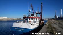 The British trawler kept by French authorities docks at the port in Le Havre, western France, Thursday, Oct. 28, 2021. French authorities fined two British fishing vessels and kept one in port overnight Thursday Oct.28, 2021 amid a worsening dispute over fishing licenses that has stoked tensions following the U.K.'s departure from the European Union. (AP Photo/Michel Euler)
