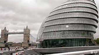 London's city hall and Tower bridge in front of a gray sky