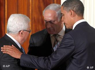 President Barack Obama shakes hands with Palestinian President Mahmoud Abbas and Israeli Prime Minister Benjamin Netanyahu after delivering remarkes on the Middle East peace negotiations in the East Room of the White House in Washington, Wednesday, Sept. 1, 2010. (AP Photo/Charles Dharapak)