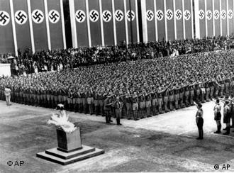 Nazi soldiers line up in front of the Olympic flame