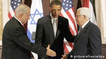Barack Obama greets Benjamin Netanyahu and Mahmoud Abbas
