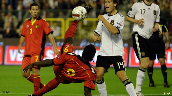 Germany's Holger Badstuber, third from left, is challenged by Romelu Lokaku