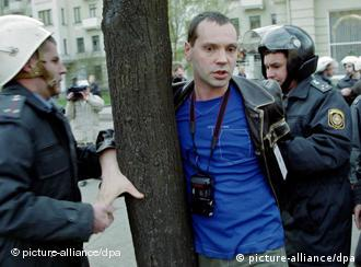 A undated handout photograph made available on 04 September 2010 showing Belorussian riot police detain Oleg Bebenin in Minsk, Belarus.