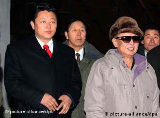 Unconfirmed picture of North Korean heir-apparent Kim Jong-un (left) and leader Kim Jong-il (right)