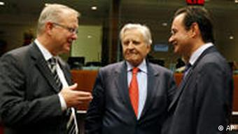 European Central Bank President Jean Claude Trichet, center, speaks with European Commissioner for Economy Olli Rehn, left, and Greek Finance Minister George Papaconstantinou, right, during a meeting of EU finance ministers at the EU Council building in Brussels on Tuesday, Sept. 7, 2010. European finance ministers meet Tuesday to discuss taxes on banks. (AP Photo/Virginia Mayo)