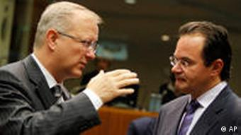 European Commissioner for Economy Olli Rehn, left, gestures while speaking with Greek Finance Minister George Papaconstantinou during a meeting of EU finance ministers at the EU Council building in Brussels on Tuesday, Sept. 7, 2010. European finance ministers meet Tuesday to discuss taxes on banks. (AP Photo/Virginia Mayo)