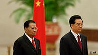 Chinese President Hu Jintao, right, and Myanmar's top junta leader Gen. Than Shwe stand for national anthems