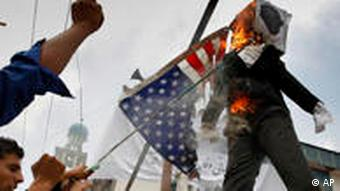 Protestors burn the US flag in respons to Jones' plans