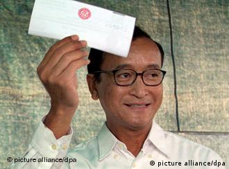 Opposition party leader Rainsy in happier times