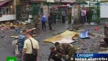 TV grab taken 09 September 2010 from the Russian TV channel NTV shows the site of a suicide car-bomb explosion at the central market in Vladikavkaz, the capital of the North Ossetia republic in the northern Caucasus of Russia. The death doll of the bombing grew to 14, another 85 people were wounded, according to the North Ossetian Interior Ministry information. EPA/NTV pixel