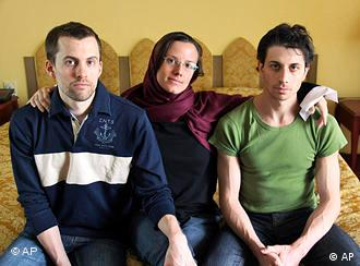 FILE - In this May 20, 2010 file photo, American hikers Shane Bauer, left, Sarah Shourd, center, and Josh Fattal, sit at the Esteghlal Hotel in Tehran, Iran. Iran announced Thursday that one of the three Americans jailed for more than a year will be released Saturday to mark the end of Islamic holy month of Ramadan. (AP Photo/Press TV, File)