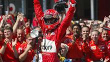 German Ferrari driver Michael Schumacher jubilates in front of his team after winning the German Grand Prix at the Hockenheim race track in Hockenheim, Germany, on Sunday, July 28, 2002. (AP Photo/Eckehard Schulz)