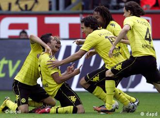 Dortmund players celebrate Sahin's goal