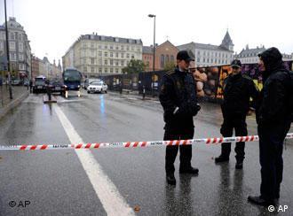Police guard a cordon in central Copenhagen