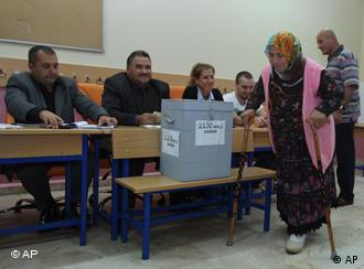 A Turkish woman leaves a polling station after casting her vote in a referendum on changes to the constitution