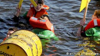 Greenpeace protestors swimming in Berlin, campaigning against extended use of nuclear power.