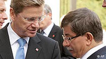 The foreign ministers of Germany and Turkey, from left, Guido Westerwelle and Ahmet Davutoglu