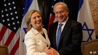 U.S. Secretary of State Hillary Rodham Clinton, left shakes hands with Israeli Prime Minister Benjamin Netanyahu during their meeting at the Red Sea resort of Sharm el-Sheikh, Egypt Tuesday Sept. 14, 2010. Clinton said the time is ripe for Mideast peace, but that without face-to-face talks Israel can't expect lasting security and the Palestinians can't create an independent state. (AP Photo/Nasser Nasser)