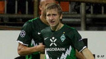Bremen's Marko Marin celebrates after scoring his side's 2nd goal during the Champions League Group A soccer match between Werder Bremen and Tottenham Hotspur in Bremen, Germany, Tuesday, Sept. 14, 2010.