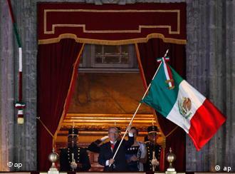 Mexico's President Felipe Calderon waving the national flag