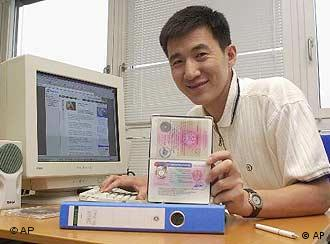 An Mongolian computer specialist showing his work permit