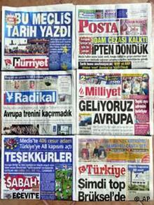 Front pages of some Turkish papers on Saturday, Aug. 3, 2002 read: This parliament has written history, Death penaty is lifted--We have escaped hanging, We did not miss Europe train, Europe, we are coming, The ball is in Brussels' court, Thank you. ( AP Photo/Burhan Ozbilici)