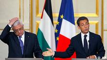 French President Nicolas Sarkozy, right, reacts during a meeting with Palestinian President Mahmoud Abbas at the Elysee Palace Monday, Sept. 27, 2010 in Paris. Palestinian President Mahmoud Abbas said Sunday that Israel must choose between peace or settlements as Israel's 10-month settlement construction slowdown expired. (AP Photo/Jacques Brinon)