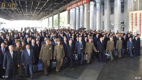 Members of the ruling Worker's Party gather at Pyongyang station on their way to the party conference
