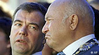 Russian President Dmitry Medvedev, left, talks to former Moscow mayor Yuri Luzhkov