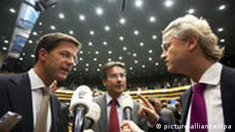 Dutch liberals leader Mark Rutte (L), Christian Democrats leader Maxime Verhagen (C) and Freedom party leader Geert Wilders
