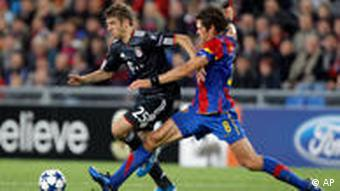 Basel's Benjamin Huggel, right, and Munich's Thomas Mueller challenge during the Champions League Group E soccer match between FC Basel and FC Bayern Munich in Basel, Switzerland, on Tuesday, Sept. 28, 2010.